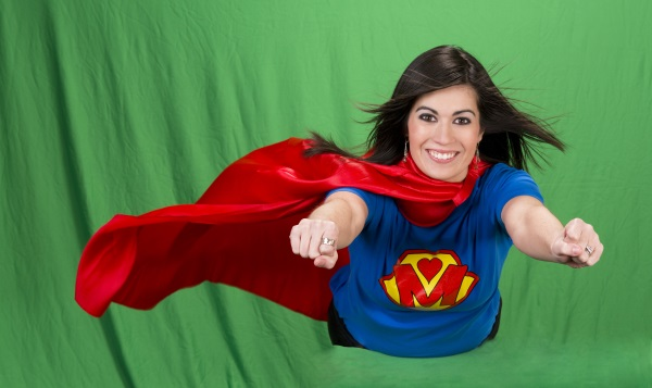 Beautiful woman plays super mom flying on green screen
