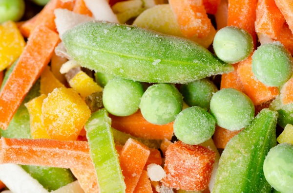 closeup to group of mixed frozen vegetables